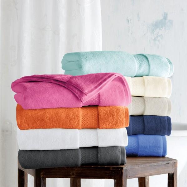 Toallas de baño en rizo 100% algodón con cenefa jacquard de viscosa ton / ton. Varios tamaños y colores.