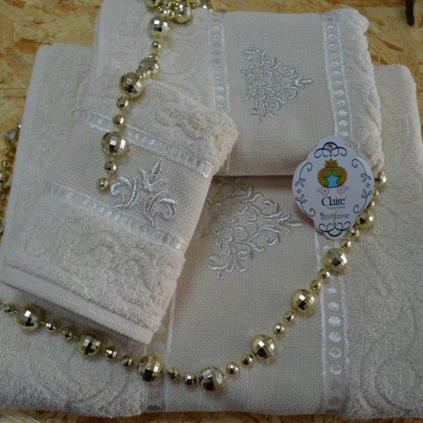 Toallas de baño en rizo 100% algodón con cenefa jacquard de algodón y viscosa ton / ton con bordado.