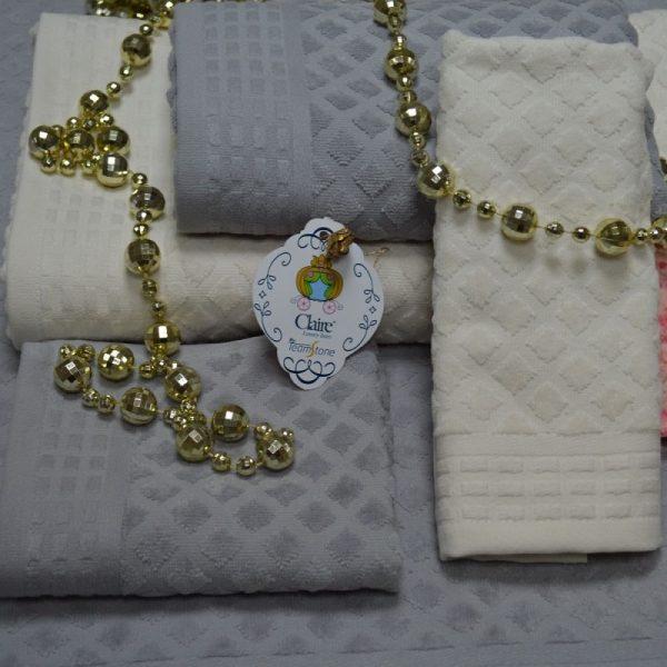Toallas de baño en rizo 100% algodón con cenefa jacquard en algodon ton/ton. Toque y acabado velour.