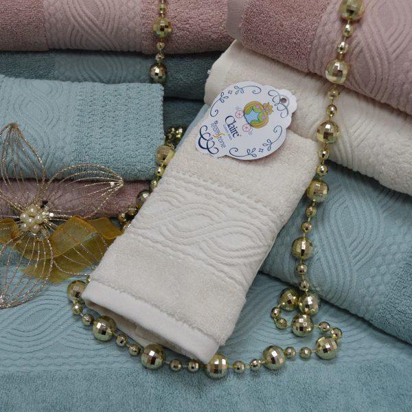 Toallas de baño en rizo 100% algodón con cenefa jacquard de algodón ton / ton.