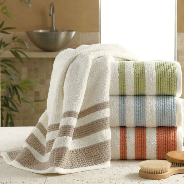100% cotton terry bath towels with 3 decorative borders. Velour touch and finish.